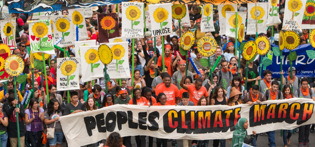 This image has an empty alt attribute; its file name is Screenshot_2020-06-09-Peoples-Climate-March-1024x478.png